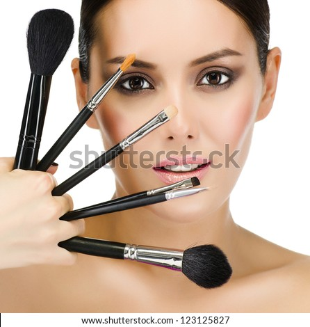 portrait of attractive  caucasian  woman brunette isolated on white studio shot looking at camera face skin makeup closeup brushes - stock photo
