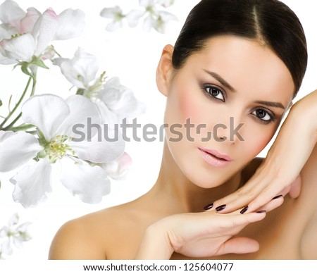 portrait of attractive  caucasian  woman brunette isolated on white studio shot looking at camera face skin closeup flowers - stock photo