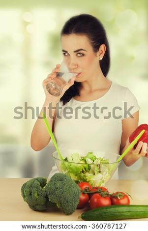 portrait of attractive caucasian woman eating salad - stock photo