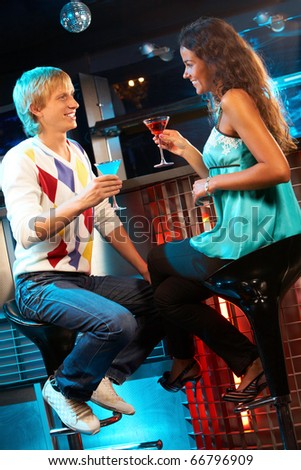 Portrait of attractive couple chatting in the bar - stock photo