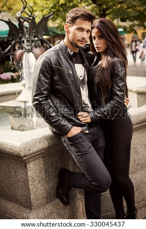 Portrait of attractive couple in leather jacket. Autumn photo - stock photo