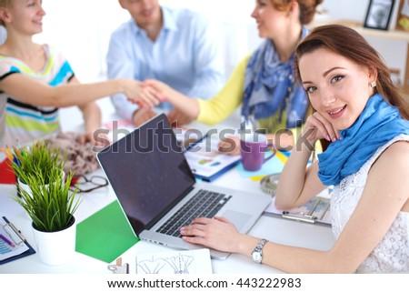 Portrait of attractive female designer in office - stock photo