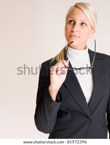 Portrait of attractive friendly thoughtful business woman. - stock photo