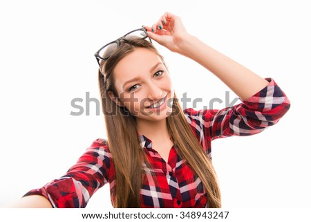 Portrait of attractive girl wearing glasses on white background - stock photo