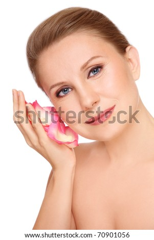 Portrait of attractive groomed healthy middle-aged woman with rose petals in her palm, on white background - stock photo