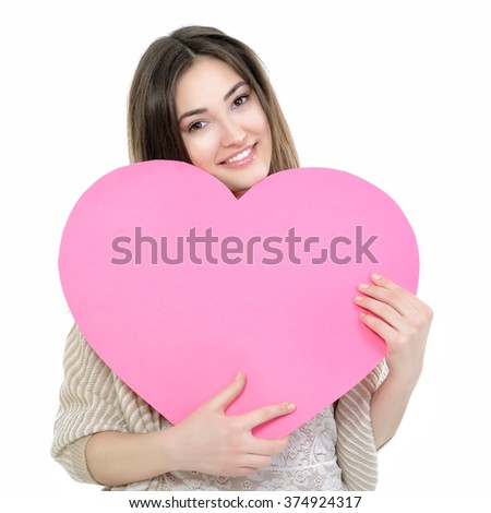 Portrait of attractive happy smiling teen girl with pink heart, love holiday valentine symbol over white background - stock photo