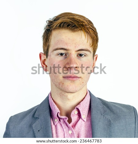 portrait of attractive laughing smiling boy in puberty in studio - stock photo