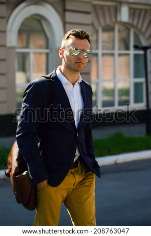 Portrait of attractive man with casual clothes walk in Europe. Street photo.  - stock photo