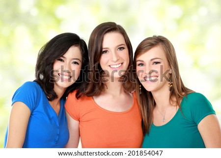 portrait of attractive multi racial three girls best friend together smiling - stock photo