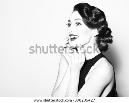 Portrait of attractive sensual glamour retro elegant young adult smiling woman with classic hairstyle and red lips in evening dress indoor black and white, horizontal picture - stock photo