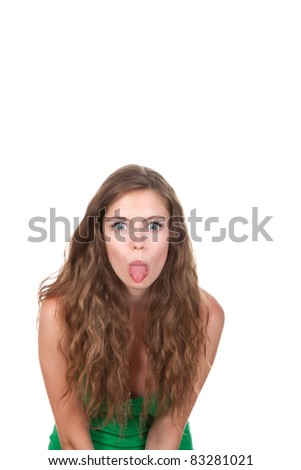 portrait of attractive smile teenage girl, show her tongue, wear green shirt, brown long hair, isolated over white background, concept of emotional student, young pretty woman - stock photo
