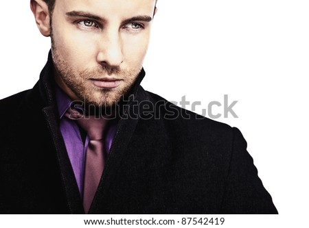 Portrait of attractive & successful young business man in black coat. - stock photo