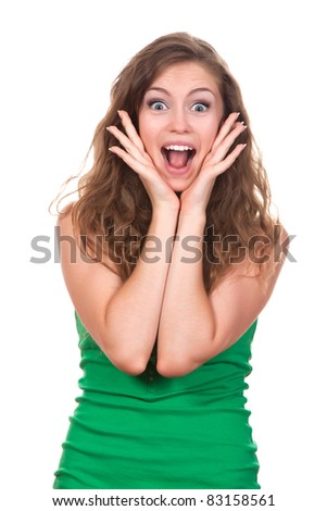 portrait of attractive surprised excited smile teenage girl wear green shirt, with white teeth, brown long hair, isolated over white background concept of happy student, young pretty woman - stock photo
