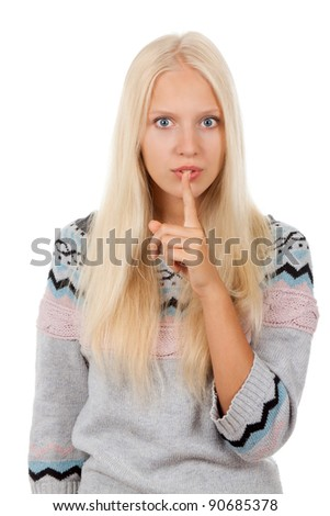 portrait of attractive teenage girl with finger on lips show quiet, silence, secret gesture wear warm knit sweater, isolated over white background - stock photo