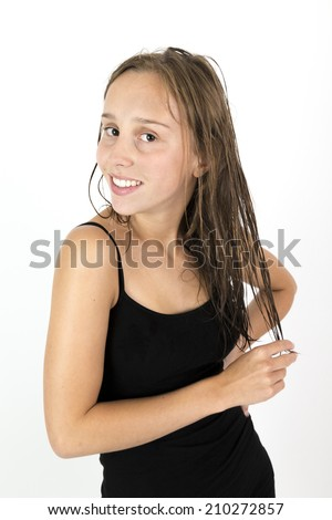 portrait of attractive teenage girl with long brown hair - stock photo