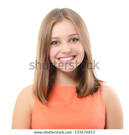 portrait of attractive teenager girl smiling in cheerful mood, over white - stock photo