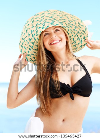 Portrait of attractive woman in a straw hat. Medium format image. - stock photo