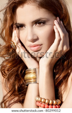 portrait of attractive woman in the desert with bracelets - stock photo