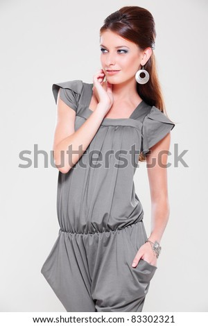 portrait of attractive woman posing over grey background - stock photo
