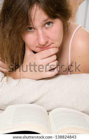 portrait of attractive woman with a book - stock photo