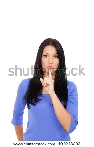portrait of attractive woman with finger on lips, isolated over white background concept of show quiet, silence, secret gesture, young casual pretty girl - stock photo