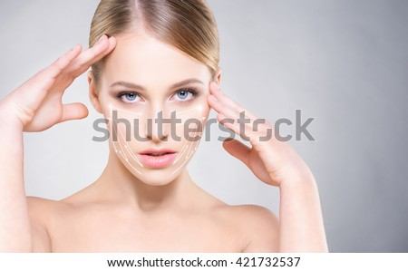 Portrait of attractive woman with smooth skin and beautiful, blue eyes over grey background. Face lifting concept. - stock photo