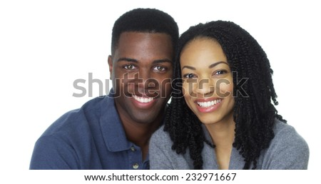 Portrait of attractive young black couple looking at camera - stock photo