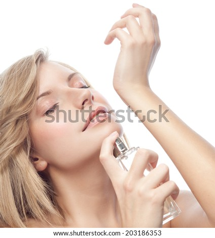 portrait of attractive young caucasian smiling woman isolated on white studio shot applying parfume face closeup beauty - stock photo