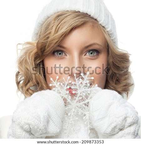 portrait of attractive young caucasian woman   face skin care in warm clothing  studio  shot isolated on white  winter snowflake - stock photo