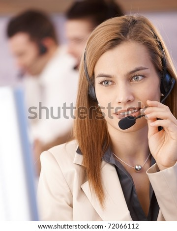 Portrait of attractive young female dispatcher smiling in call center.? - stock photo