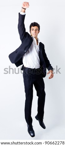 Portrait of attractive young man jumping - stock photo