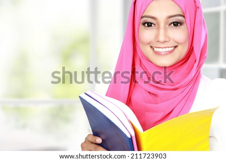 portrait of attractive young student studying - stock photo