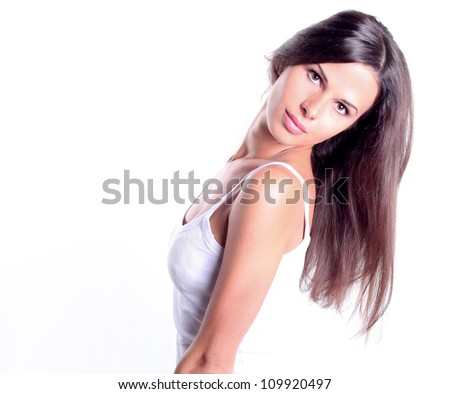 Portrait of attractive young woman against white background - stock photo