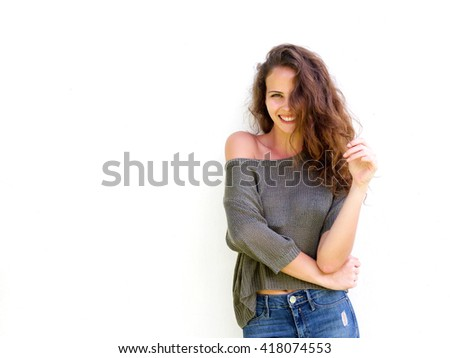 Portrait of attractive young woman laughing playing with long hair - stock photo