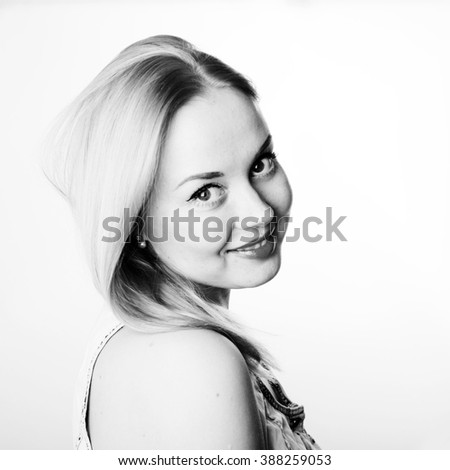 Portrait of attractive young woman with blond hair and red lips - stock photo