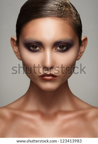 Portrait of attractive young woman with creative bright makeup - stock photo