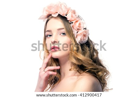Portrait of attractive young woman with pink flower wreath on head looking at camera.Isolated. - stock photo