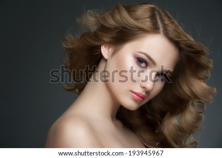 Portrait of attractive young woman with stylish makeup and beautiful hairstyle - stock photo