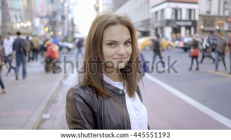 portrait of attractive young women. happy smiling female model. urban city background - stock photo