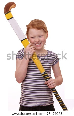 Portrait of ayoung girl holding a hockey stick isolated on white background - stock photo
