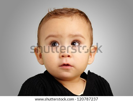 Portrait Of Baby Boy against a grey background - stock photo