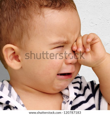 Portrait Of Baby Boy Crying against a grunge background - stock photo