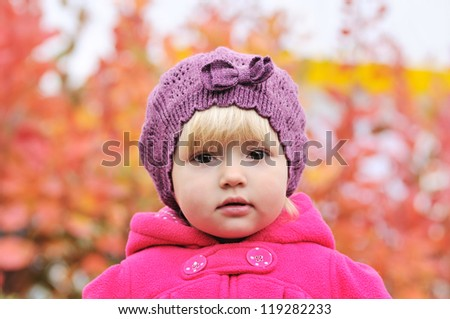 portrait of baby girl in fall time - stock photo
