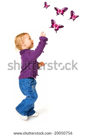Portrait of baby girl looking up to reach butterflies - stock photo