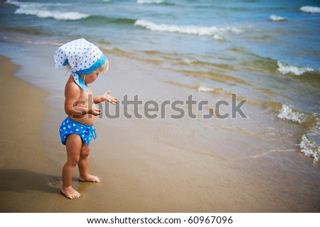Portrait of baby girl on the beach. - stock photo