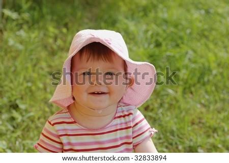 Portrait of baby in hat - stock photo