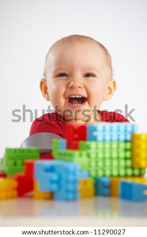 portrait of baby with toys - stock photo