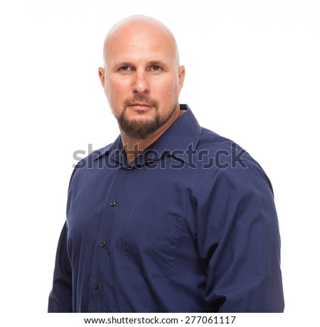Portrait of bald, handsome young man isolated on white background. Caucasian man with beard looking serious. - stock photo