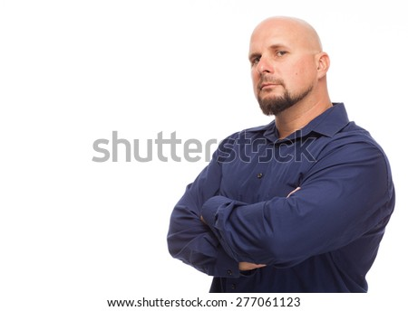 Portrait of bald, handsome young man isolated on white background. Caucasian man with beard looking serious with arms crossed. - stock photo