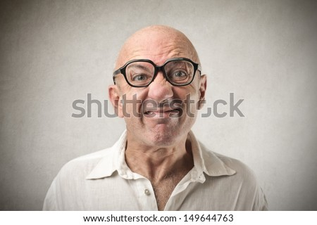 portrait of bald man making grimace - stock photo